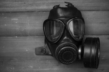 black gas mask on wood background with Black & White  Color