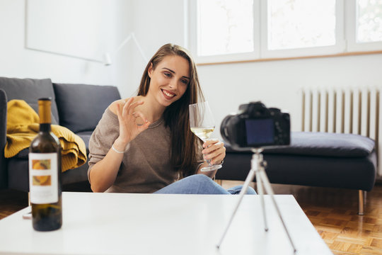 woman wine blogger making video