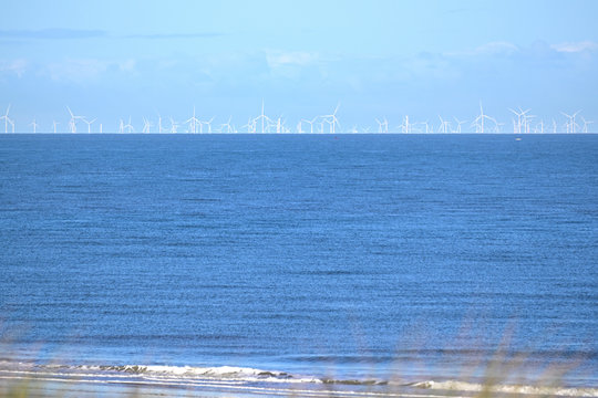 Offshore wind farm in the north sea as seen from the beach