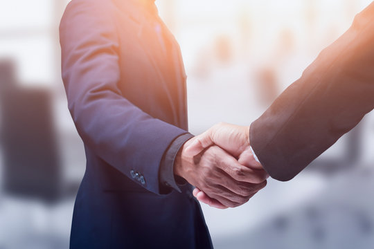 Concept business deals. Business people shake hands. - Image