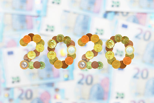 New year concept. 2020 inscription made from euro coins on 20 euro banknotes. Money concept