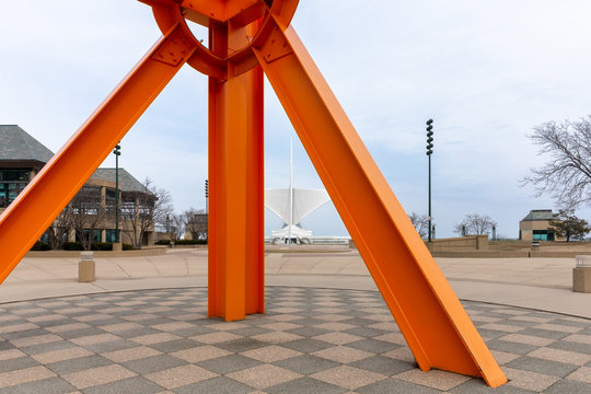 Milwaukee Art Museum Seen Through the Orange Sculpture The Calling on April 11, 2018 in Milwaukee, Wisconsin