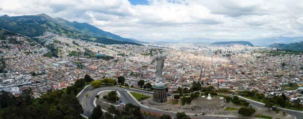Poster Grijs Beautiful view of Virgen del Panecillo statue on top of a hill in the historical center of Quito Ecuador