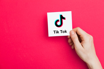 LONDON, UK - January 9th 2019: Hand holding Tik Tok logo. Tik Tok is a ido sharing social media network