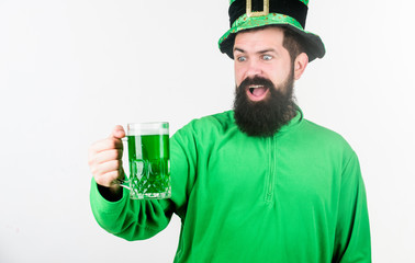 Raising the green and stepping out. Irish man with beard drinking green beer. Hipster in leprechaun hat holding beer mug. Bearded man toasting to saint patricks day. Celebrating saint patricks day