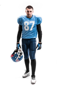 American Football Player with blue uniform on the scrimmage line. White background.