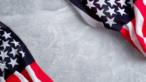 Frame of US American flags on stone background. Banner template for Presidents day, USA Memorial day, Veterans day, Labor day, or 4th of July celebration. With blank space for text