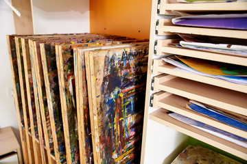 A lot of artist easels in a studio workshop