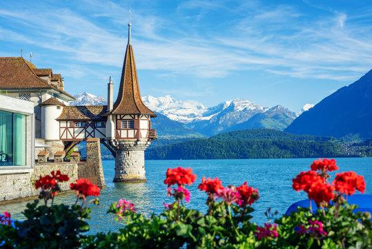 Oberhofen castle on Lake Thun, Switzerland, Alps mountains