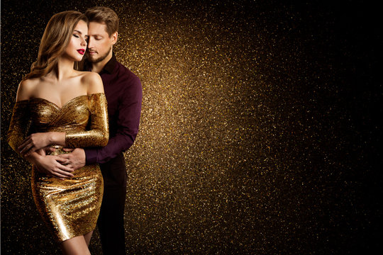 Couple Beauty Portrait, Dreaming Beautiful Woman in Gold dress embracing Elegant Man, Love concept