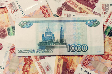Texture of banknotes in denominations of 5000 and 1000 Russian rubles.