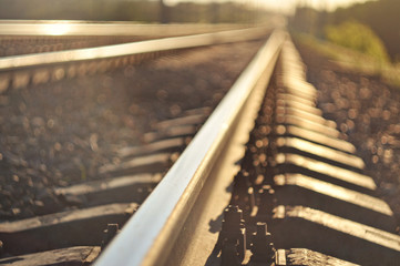 Foto auf Acrylglas Eisenbahnschienen Railroad closeup. rails blurred background