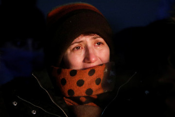 An attendee at a candle light vigil for the victims of Ukraine International Airlines flight PS-752 on Parliament Hill in Ottawa
