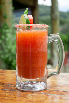 Drink made with beer, tomato juice and spices, garnished with salt on the edge of the jar in Guatemala is called Michelada.