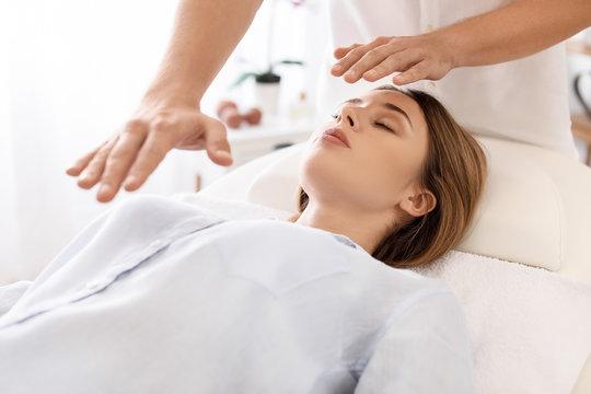 Reiki master working with patient
