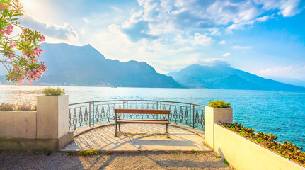 Bench on lakefront in Como Lake landscape. Bellagio Italy Fotomurales
