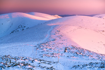 Montage in der Fensternische Rosa hell Winter mountains ridge in pink sunrise colors, hills covered by white snow