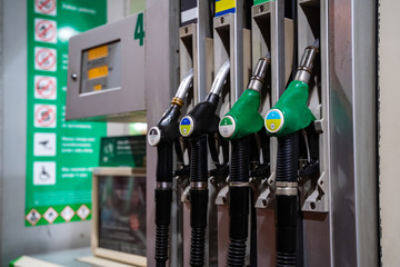 Gasoline and diesel distributor at the gas station. Gas pump nozzles. Petrol filling gun close-up at the gas station. Colorful Petrol pump filling nozzles. Fuel pump