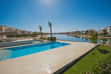 Swimming pool at at luxury tropical holiday villa resort