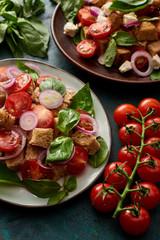 Photo sur Aluminium Fleur fresh Italian vegetable salad panzanella served on plates on table with tomatoes