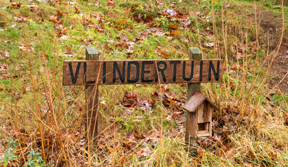 Sign wtih the text 'Vlindertuin' in the early year of spring you can find butterflies.