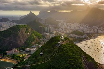 Fototapete - Sunset view of Corcovado, Copacabana, Urca and Botafogo in Rio de Janeiro, Brazil. Skyline of Rio de Janeiro