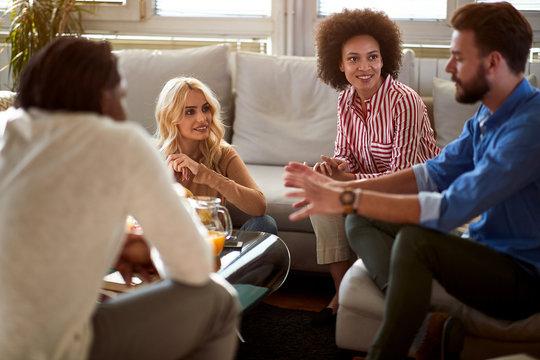 Group of people in room talks