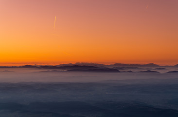 Zagreb Skyline in Croatia. Sunset Light Colorful Sky in Background. View from the top of Medvednica Mountain.