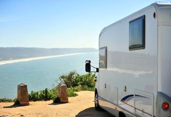 Travel camper van parking over the sea