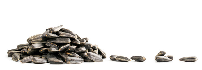 Pile of sunflower seeds and scattered close-up on a white background. Isolated