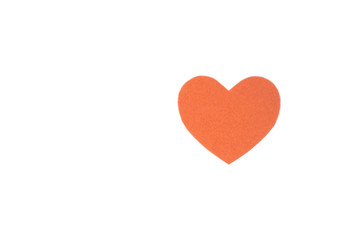 Оne felt orange heart on a white isolated background. Stock photo for the day of St. Valentine with empty space for your text. For web, print, postcards and wallpaper.