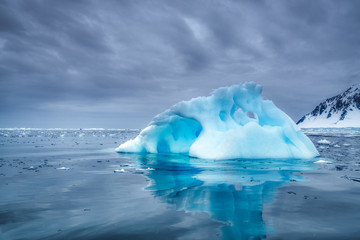 Piece melting iceberg in arctic water