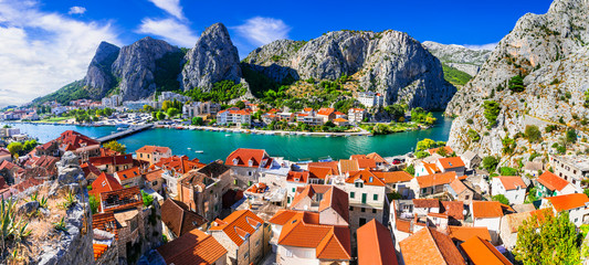 Landmarks of Croatia - impressive Omis town popular tourist destination for trekking and rafting over Cetina river