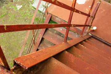 metal stairs. abandoned urban background full of rusty texture. view downside