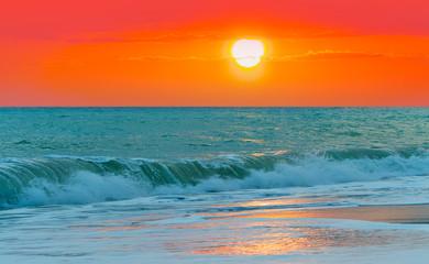Wall Mural - Beautiful sunset in front of the sea- orange sun
