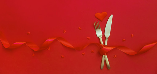 Romantic dinner for Valentine's day on a red background. Selective focus.