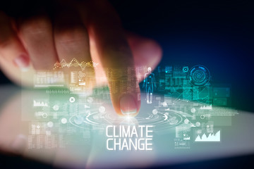 Finger touching tablet with web technology icons and CLIMATE CHANGE inscription
