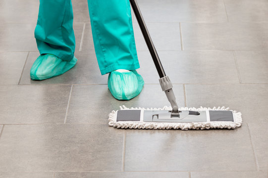 Floor care and cleaning services with washing mop in sterile operating room or clean hospital