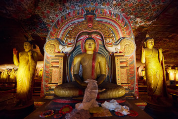 Sitting Buddha, statue in Dambulla cave temple. UNESCO Golden Temple of Dambulla, beautiful sacred place in Sri Lanka. Very popular tourist place.