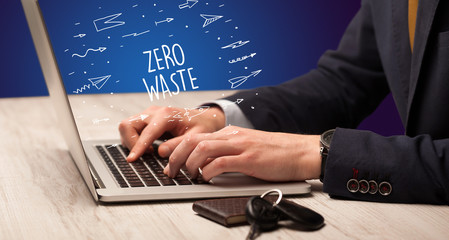 Businessman working on laptop with ZERO WASTE inscription, online shopping concept