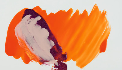 Mixed paint on orange color background