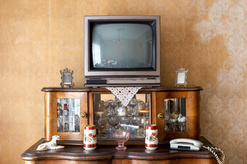 Old fashioned interior - vintage television set on stand Wall mural