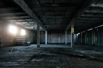 Old broken empty abandoned industrial building interior