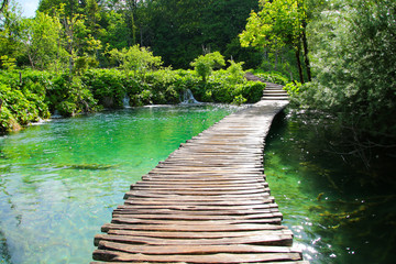 Door stickers Road in forest Wooden footbridge built above the blue waters of the Plitvice Lakes National Park in Croatia