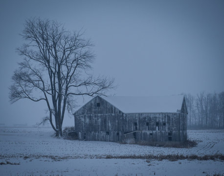 Old Indiana barn during winter snow storm