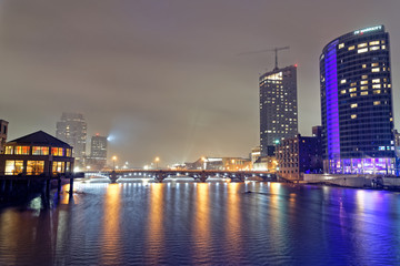 Downtown Grand Rapids at night, blue bridge fog, over the grand river