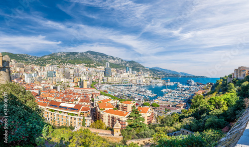 Wall mural View on Principality of Monaco with luxury yachts on port, French Riviera coast, Cote d'Azur, France