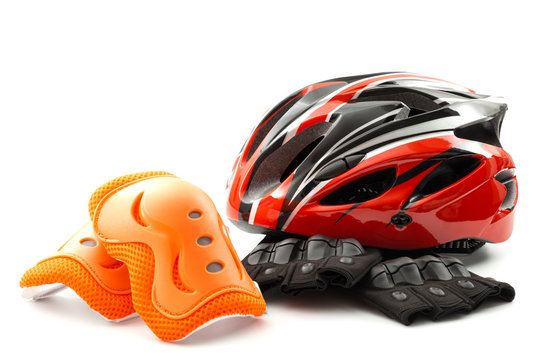Cycling safety equipment and bicycle riding gear conceptual idea with red bike helmet, fingerless gloves and orange knee pads isolated on white background