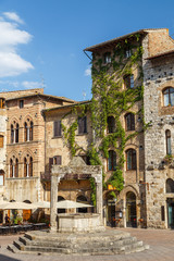 SAN GIMIGNANO / ITALY - JULY 2015: Square in the historic centre of San Gimignano town, Italy