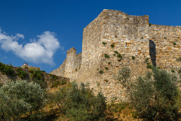 Medieval fortification walls tower in San Gimignano town, Italy